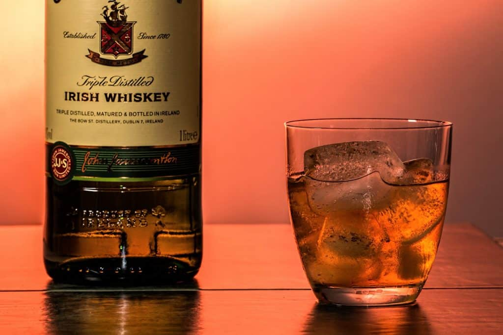 One popular way to drink whiskey is with ice cubes, to make the drink more palatable.