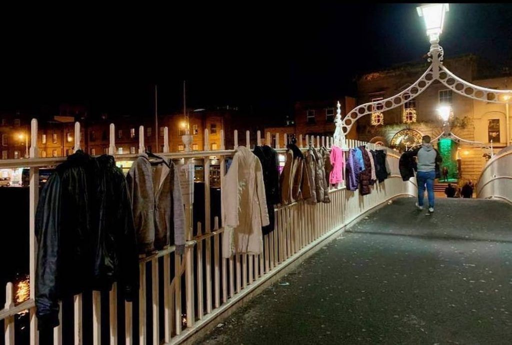 Generous Dubliners are donating coats to the homeless by hanging them on the Ha'penny Bridge