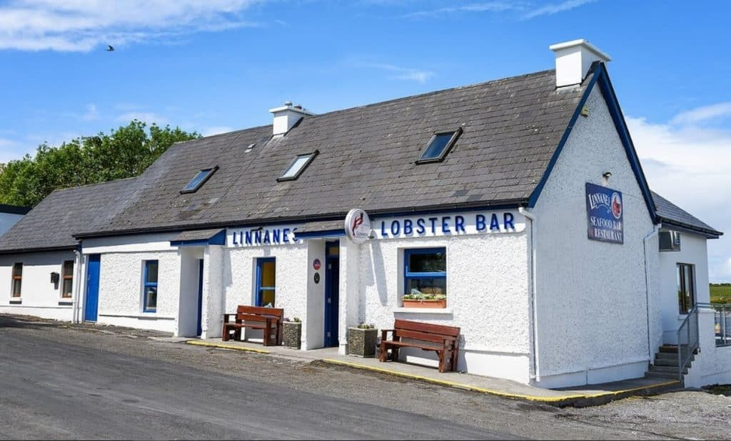 Linnane's Lobster Bar is a great spot to grab some food, it's only down the road from the pretty pink cottage on sale on Ireland's Wild Atlantic Way.
