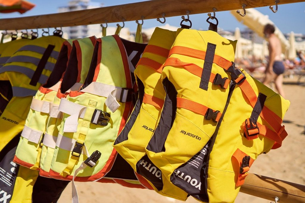 Wearing life jackets is an important tip to remember for swimming safely in Ireland, it's better to be safe than sorry.
