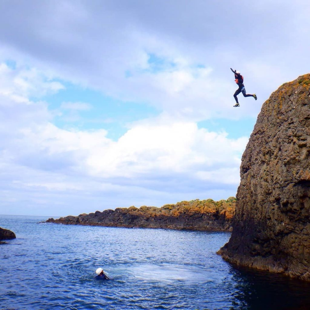 Cliff jumping in Ballintoy with Coasteerig NI is a thrilling activity