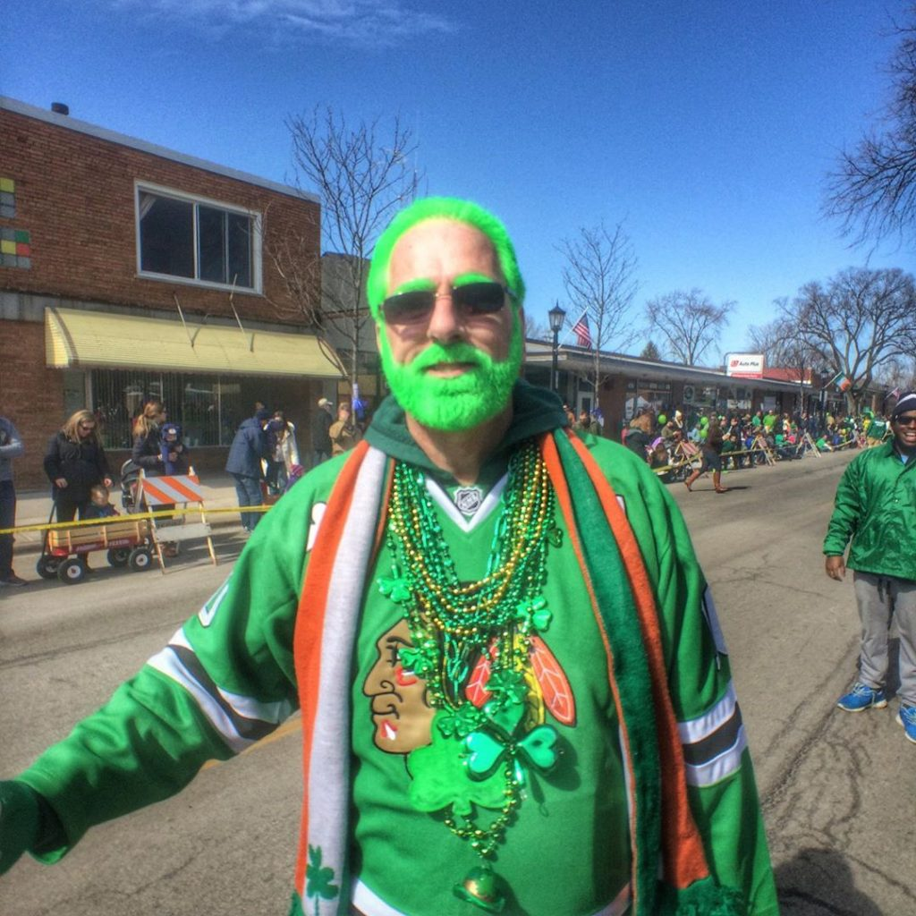 This man truly knows how to create one of the top St Patrick's Day outfits, when in doubt always add green hair dye.