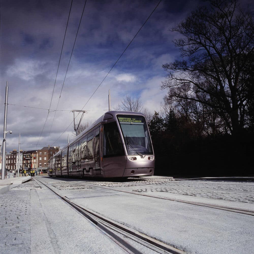 The LUAS as it passes St. Stephen's Green. Using this as transport around the city can really help your daily costs to Dublin.
