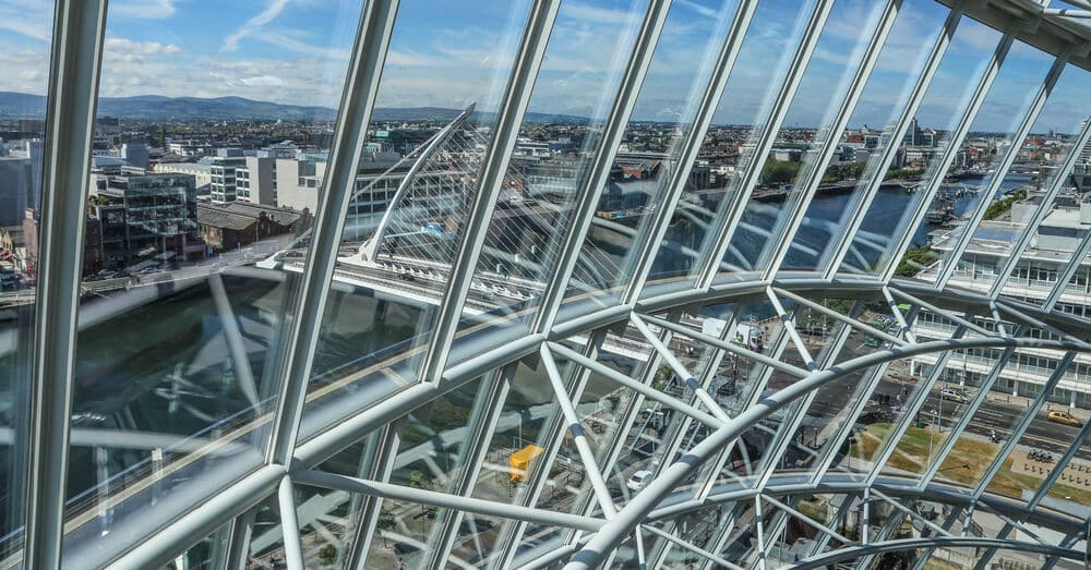 The view of Dublin city through the lens of the Convention Centre on the banks of the Liffey during a summer's day.
