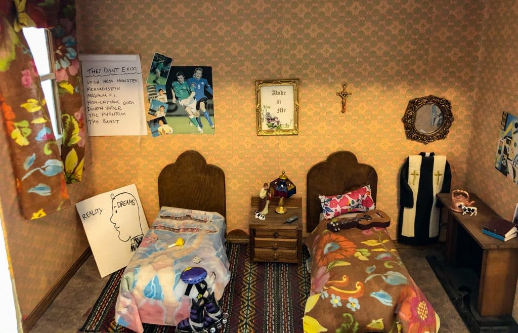 The iconic room of Dougal and Ted in the Father Ted dolls house