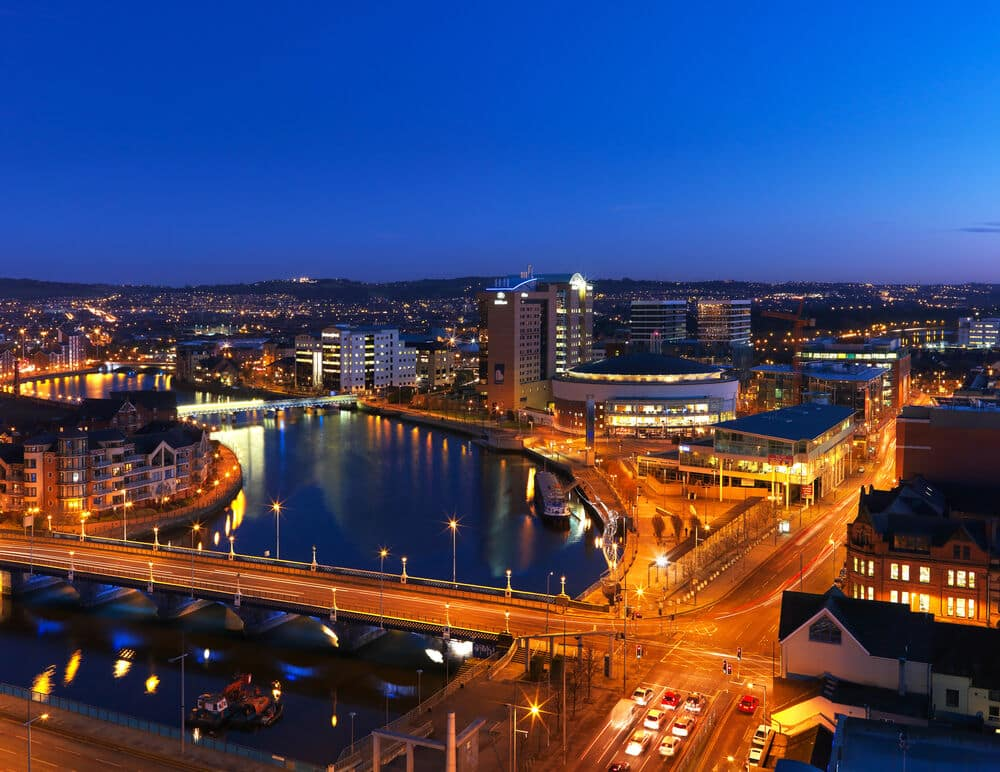 The city of Belfast is a great summer destination. Here it is pictured at nightfall.