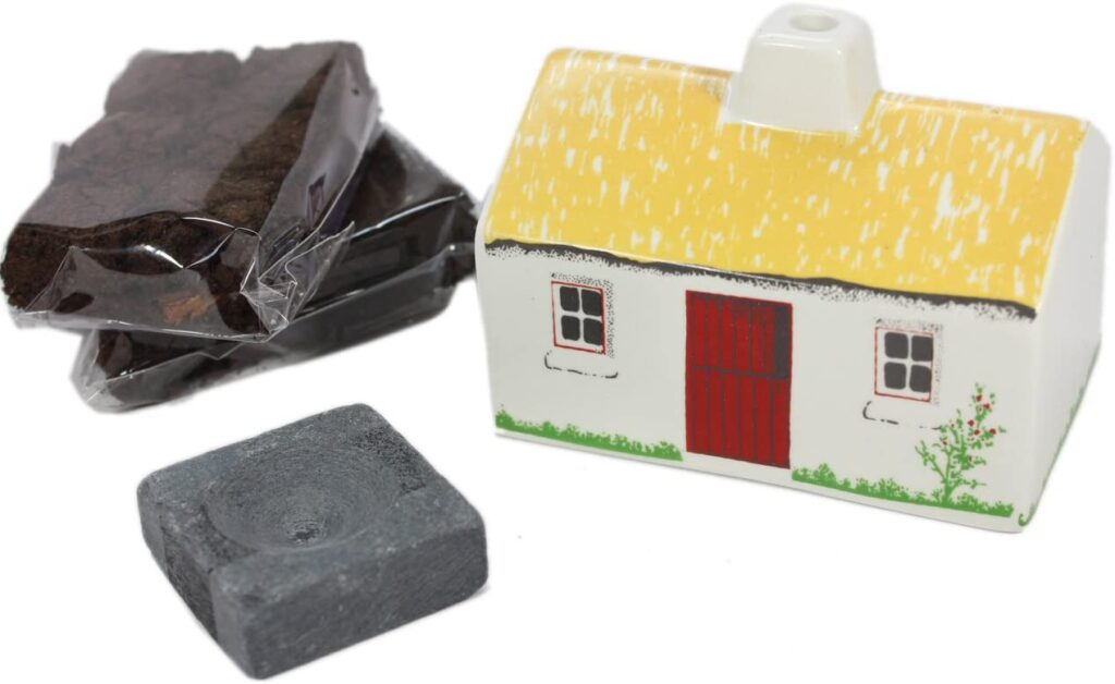 This turf peat incense ceramic cottage will remind you of Ireland.