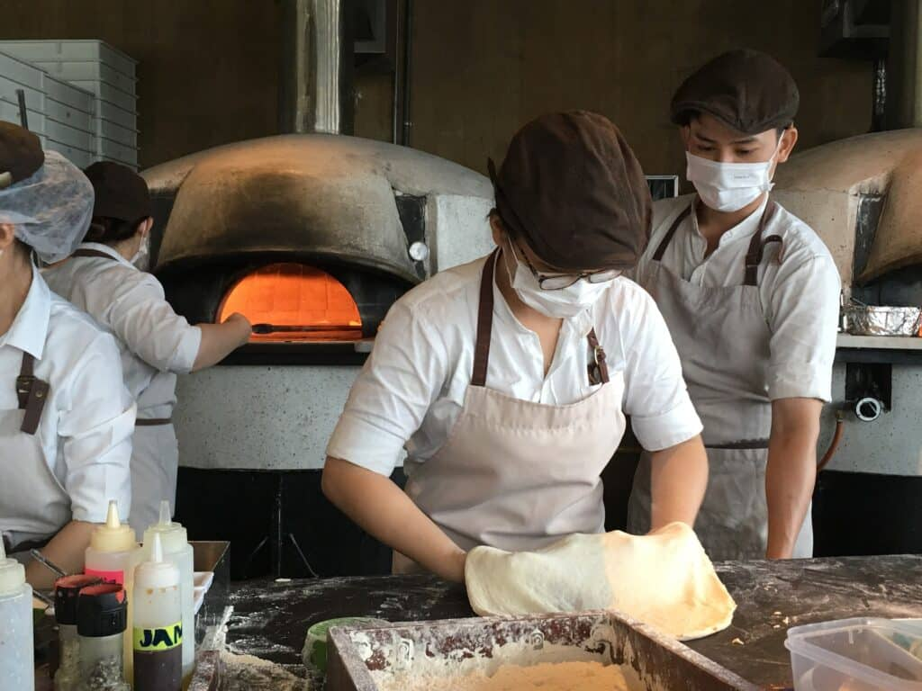 Learn to make pizza in Italy.