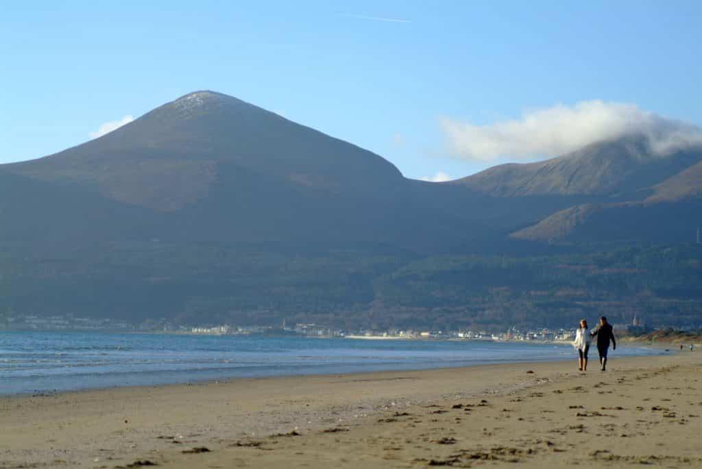 Swim beneath the mountains at Murlough Beach in County Down.