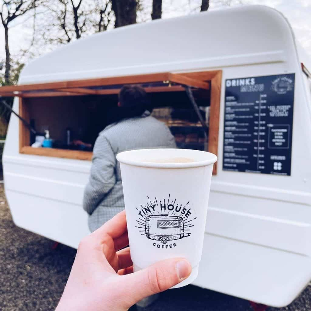 Grab a coffee from the Tiny House Coffee van.
