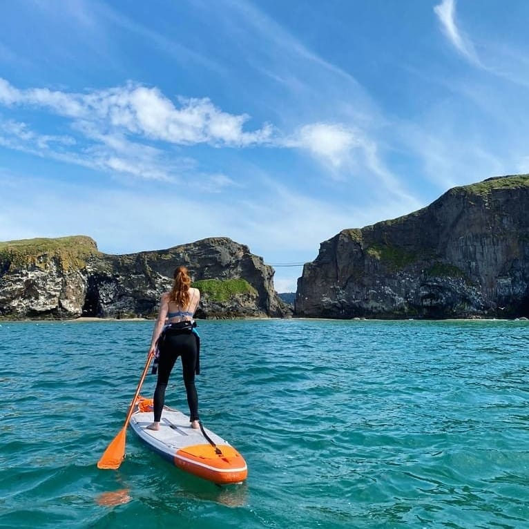 Carrick-a-Rede Rope Bridge tops our list of the best paddleboarding spots in Northern Ireland.